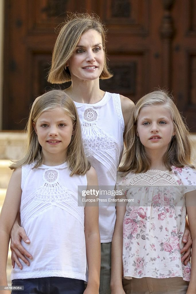 Queen Letizia of Spain and her daugthers Princess Leonor of Spain (R) and Princess Sofia of Spain (L) pose for the photographers at the Marivent Palace on August 3, 2015 in Palma de Mallorca, Spain.