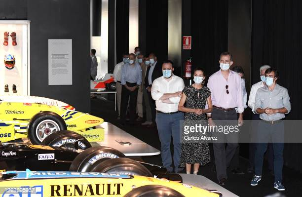 Queen Letizia of Spain and King Felipe of Spain are shown around by Fernando Alonso during a visit to the Fernando Alonso Museum and Circuit on July...
