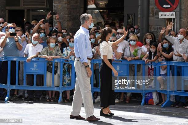 Queen Letizia of Spain and King Felipe of Spain greet well wishers in the downtown area of Jaca on July 08 2020 in Jaca Spain This trip is part of a...