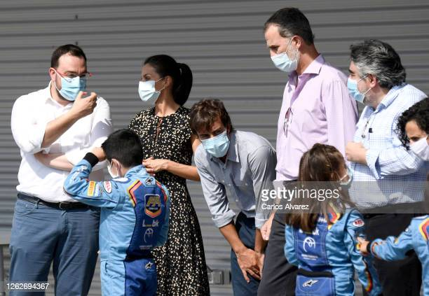 Queen Letizia of Spain and King Felipe of Spain speak with Fernando Alonso and the Minister of Culture and Sport José Manuel Rodriguez Uribes during...
