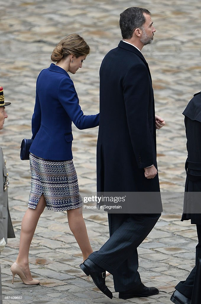 Queen Letizia of Spain and King Felipe of Spain wave to the crowd during a cermony in the courtyard of the Invalides as part of a three day official visit to France on March 24, 2015 in Paris, France.