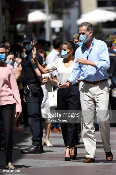 Queen Letizia of Spain and King Felipe of Spain wave to well wishers in the downtown area of Jaca on July 08 2020 in Jaca Spain This trip is part of...