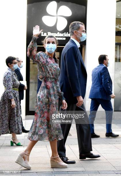 Queen Letizia of Spain and King Felipe of Spain wave to wellwishers after a visit to the new headquarters of the San Prudencio Foundation on July 17...