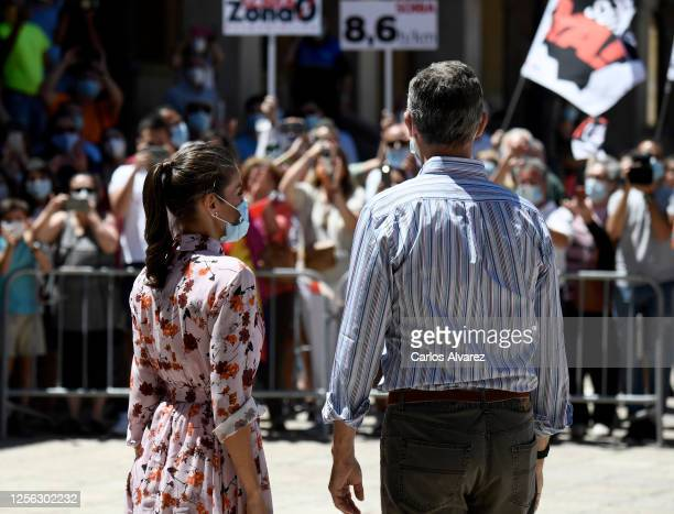 Queen Letizia of Spain and King Felipe of Spain wear face masks as they view wellwishers during a visit to a cultural centre on July 15 2020 in Soria...
