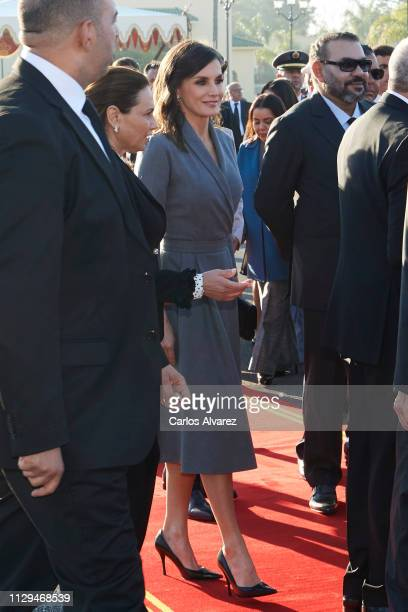 Queen Letizia of Spain and King Mohammed VI of Morocco arrive for a welcoming ceremony at the Royal Palace on February 13, 2019 in Rabat, Morocco....