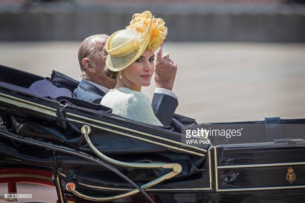 Queen Letizia of Spain and Prince Philip Duke of Edinburgh leave in a state carriage following a welcome ceremony at Horse Guards Parade on July 12...