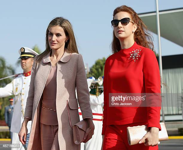 Queen Letizia of Spain and Princess Lalla Salma of Morocco walk down the red carpet at Rabat Airport on July 15 2014 in Rabat Morocco The new King...