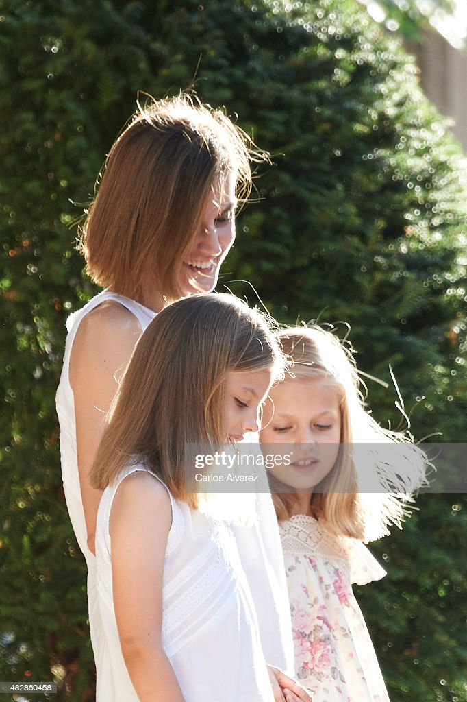 Queen Letizia of Spain and their daugthers Princess Leonor of Spain (R) and Princess Sofia of Spain (L) pose for the photographers at the Marivent Palace on August 3, 2015 in Palma de Mallorca, Spain.