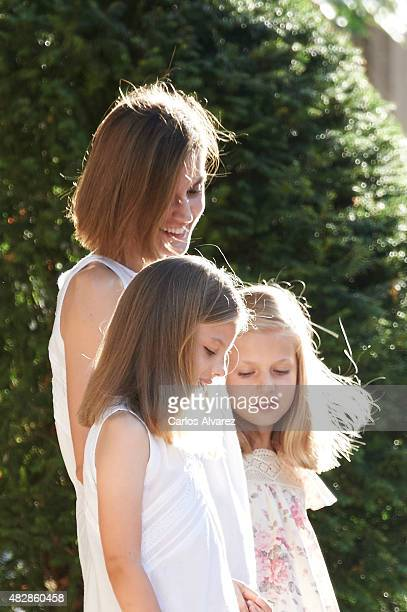 Queen Letizia of Spain and their daugthers Princess Leonor of Spain and Princess Sofia of Spain pose for the photographers at the Marivent Palace on...