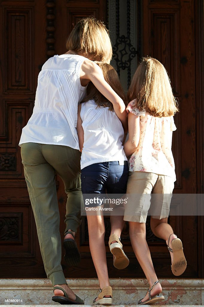 Queen Letizia of Spain (L) and their daugthers Princess Leonor of Spain (R) and Princess Sofia of Spain (C) pose for the photographers at the Marivent Palace on August 3, 2015 in Palma de Mallorca, Spain.
