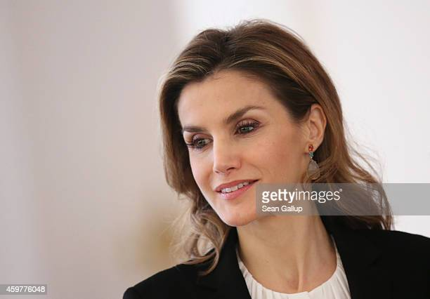 Queen Letizia of Spain attends a pressconference with her husband King Felipe VI at Schloss Bellevue presidential palace on December 1 2014 in Berlin...