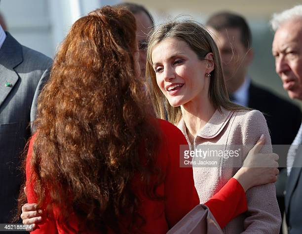 Queen Letizia of Spain embraces Princess Lalla Salma of Moroccoas the Spanish Royals prepare to leave at Rabat Airport on July 15 2014 in Rabat...