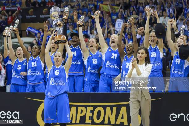 Queen Letizia of Spain hands Silvia Dominguez of Perfumerias Avenida the Queen Cup trophy at the end of the Spanish 'Queen Cup' basketball final...