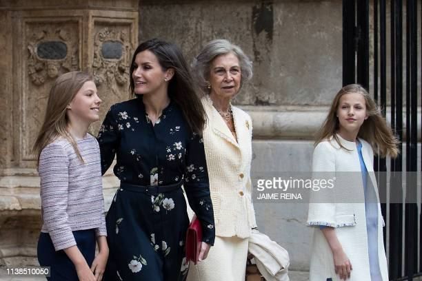 Queen Letizia of Spain , her daughters Princess Sofia and Princess Leonor , and former Queen Sofia leave after attending the traditional Easter Mass...