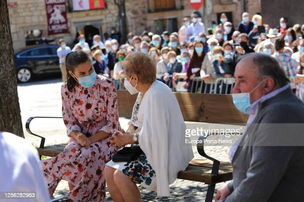 Queen Letizia of Spain is seen talking with a resident of the Soria town of Vinuesa on July 15 2020 in Vinuesa Soria Spain This trip is part of a...