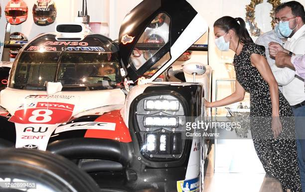 Queen Letizia of Spain is shown around by Fernando Alonso during a visit to the Fernando Alonso Museum and Circuit with King Felipe of Spain on July...