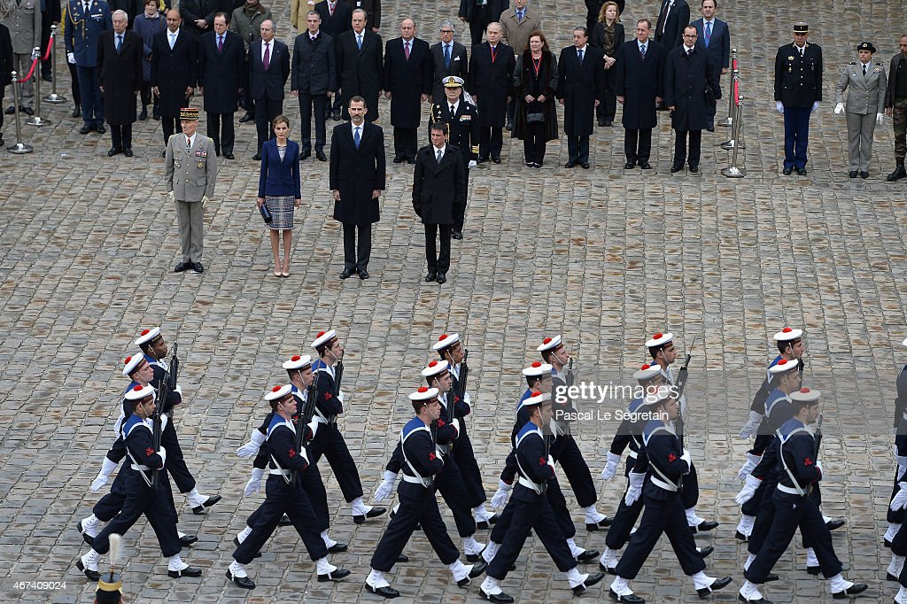 Queen Letizia of Spain, King Felipe of Spain and Prime Minister Manuel Valls attend a cermony in the courtyard of the Invalides as part of a three day official visit to France on March 24, 2015 in Paris, France.