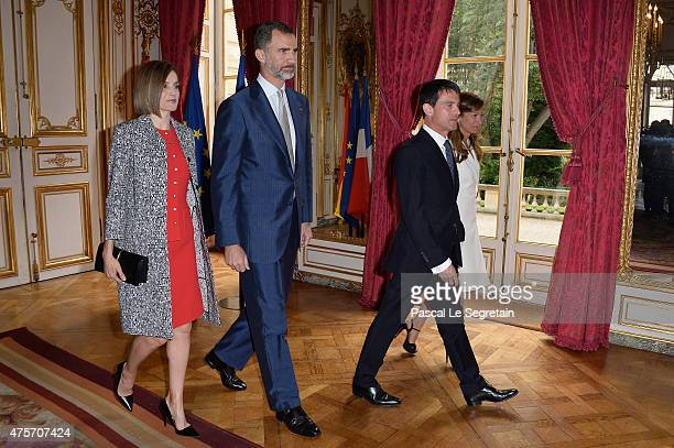 Queen Letizia of Spain King Felipe of Spain French Prime Minister Manuel Valls and wife Anne Gravoin attend a lunch at the Hotel Matignon on June 3...