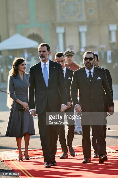 Queen Letizia of Spain, King Felipe VI of Spain and King Mohammed VI of Morocco arrive for a welcoming ceremony at the Royal Palace on February 13,...