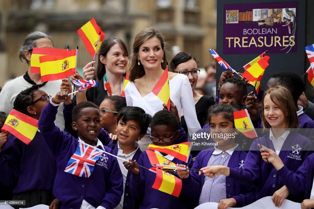 Queen Letizia of Spain (C) meets a group of school children as she arrives at the Weston Library during a State visit to the UK by the King and Queen of Spain on July 14, 2017 in Oxford, England. This is the first state visit by the current King Felipe and Queen Letizia, the last being in 1986 with King Juan Carlos and Queen Sofia.