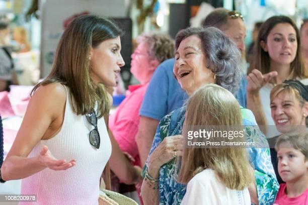 Queen Letizia of Spain Princess Sofia and Queen Sofia visit a food market on July 31 2018 in Palma de Mallorca Spain
