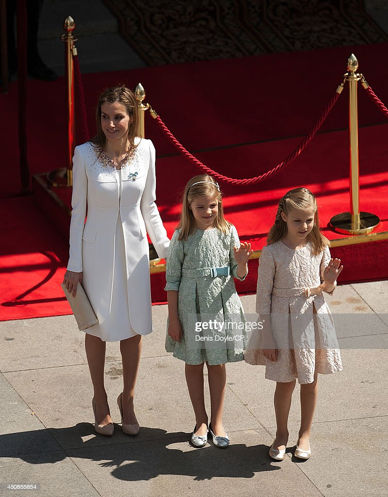 Queen Letizia of Spain smiles with her daughters Leonor (C) and Sofia outside the Spanish parliament during the Coronation of King Felipe VI on June 19, 2014 in Madrid, Spain. The coronation of King Felipe VI is held in Madrid. His father, the former King Juan Carlos of Spain abdicated on June 2nd after a 39 year reign. The new King is joined by his wife Queen Letizia of Spain.
