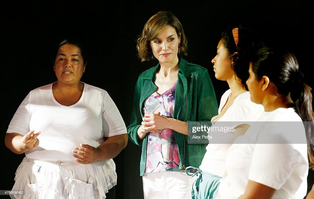 Queen Letizia of Spain talks to members of 'La Cachada Teatro' formed by saleswomen of the informal sector in pursuit of the rights of women during an official visit to El Salvadoron May 28, 2015 in San Salvador, El Salvador.
