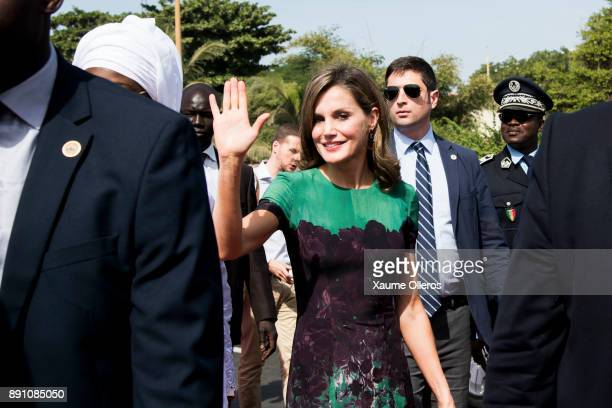 Queen Letizia of Spain waves as she arrives to an official lunch with Senegalese First Lady Marieme Faye Sall on December 12 2017 in Dakar Senegal...