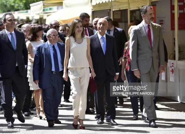 Queen Letizia Portuguese President Marcelo Rebelo de Sousa and King Felipe VI of Spain visit the Madrid Book Fair set up inside the Retiro garden on...