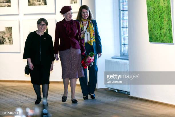 Queen Margrete of Denmark is given a guided tour as she attends the opening of the exhibition 'Thesis' at The Round Tower on March 10, 2017 in...