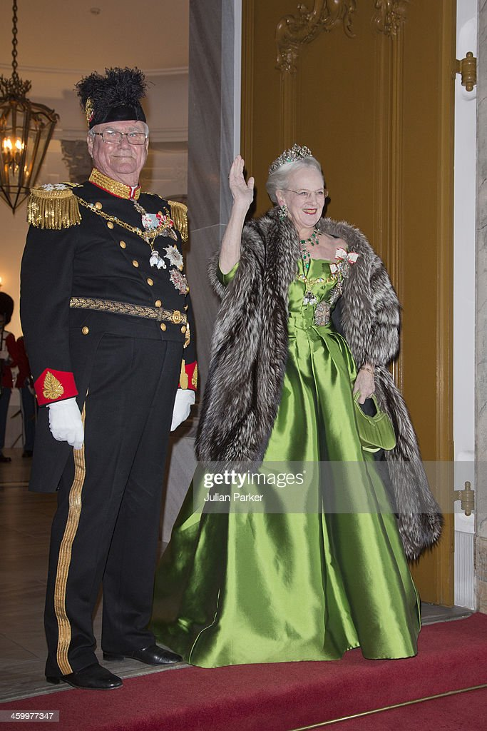Queen Margrethe and Prince Henrik of Denmark arrive at the Traditional New Year's Banquet hosted by Queen Margrethe of Denmark, at, Amalienborg Palace, on January 1, 2014 in Copenhagen, Denmark.