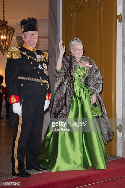 Queen Margrethe and Prince Henrik of Denmark arrive at the Traditional New Year's Banquet hosted by Queen Margrethe of Denmark at Amalienborg Palace...