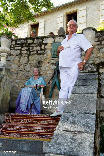 Queen Margrethe and Prince Henrik of Denmark attend a summer concert with the Royal Guards Band in the park at the Chateau de Cayx on August 21 in...