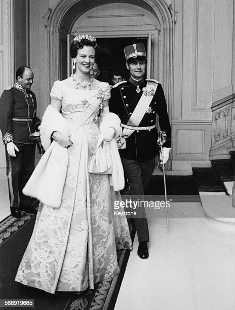 Queen Margrethe and Prince Henrik of Denmark attending a gala dinner for the Diplomatic Corps at Amalianberg Castle Denmark March 15th 1973