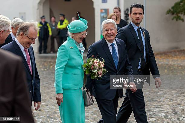 Queen Margrethe II of Denmark and German President Joachim Gauck visit the reopening ceremony of the All Saints' Church on October 2, 2016 in...