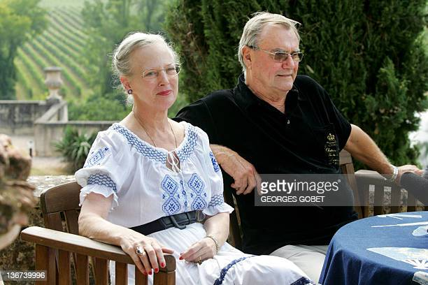 Queen Margrethe II of Denmark and her husband Prince Henrik sit in their garden before meeting journalists 11 August 2005 in the castle of Caix south...