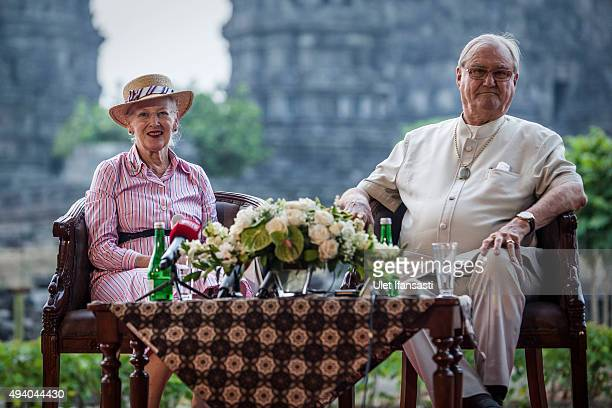 Queen Margrethe II of Denmark and her husband Prince Henrik talk to journalist during their visit at Prambanan temple on October 24 2015 in...