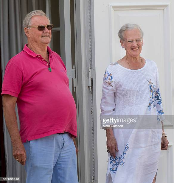 Queen Margrethe II of Denmark and Prince Henrik of Denmark watch the changing of the guard at Grasten Castle on July 25 2014 in Grasten Denmark