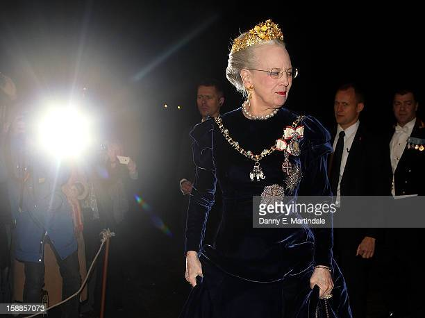 Queen Margrethe II of Denmark arrives at a New Year's Banquet hosted by Queen Margrethe of Denmark at Christian VII's Palace on January 1 2013 in...