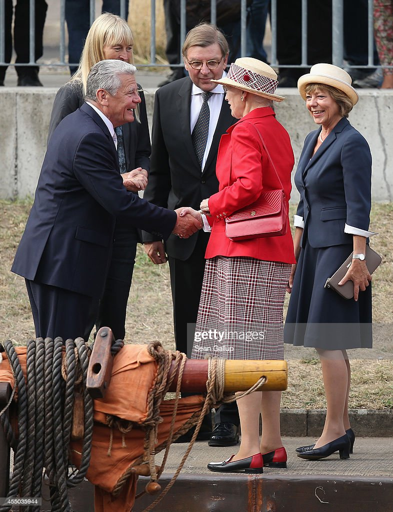 Queen Margrethe II of Denmark (C) bids farewell to German President Joachim Gauck as German First Lady Daniela Schadt (R) looks on after they visited the remake of a Viking ship on September 9, 2014 in Berlin, Germany. Queen Margrethe is in Berlin on a two-day visit, during which she will open an exhibition about the Vikings at Martin-Gropius-Bau.