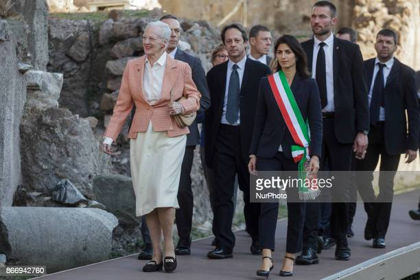 Queen Margrethe II of Denmark is flanked by Virginia Raggi, Mayor of Rome, as she visits the archaeological site of the Roman Forum during her...
