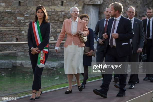 Queen Margrethe II of Denmark is flanked by Virginia Raggi , Mayor of Rome, as she visits the archaeological site of the Roman Forum during her...