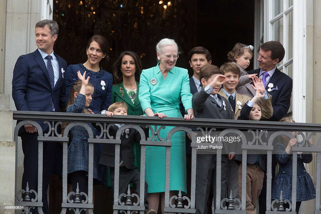 Queen Margrethe II of Denmark (C) is joined by Frederik, Crown Prince of Denmark, Princess Isabella of Denmark, Crown Princess Mary of Denmark, Prince Vincent of Denmark, Prince Christian of Denmark, Prince Nikolai of Denmark, Prince Felix of Denmark, Prince Henrik of Denmark, Princess Athena of Denmark held by her father Prince Joachim of Denmark and Princess Josephine of Denmark on the balcony during her 75th birthday at Amalienborg Palace on April 16, 2015 in Copenhagen, Denmark.