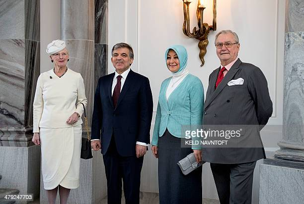 Queen Margrethe II of Denmark Prince Consort pose with Turkish president Abdullah Gul and his wife Hayrunnisa Gul on March 17 2014 at the royal...