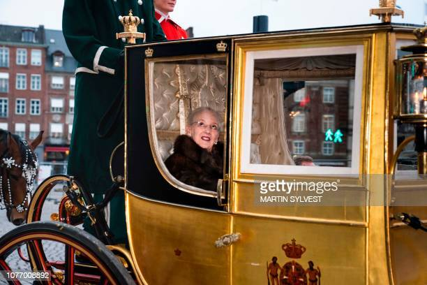 Queen Margrethe II of Denmark rides in the golden carriage from Christian VII's Palace, Amalienborg to a New Year's reception at Christiansborg...