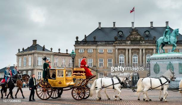 Queen Margrethe II of Denmark rides in the golden carriage from Christian VII's Palace Amalienborg to a New Year's reception at Christiansborg Palace...