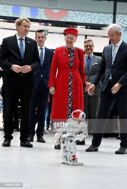Queen Margrethe II of Denmark SchleswigHolstein's State Premier Daniel Guenther and Director of the SchleswigHolstein University Hospital Jens Scholz...