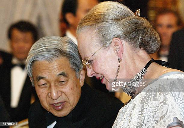 Queen Margrethe II of Denmark talks with Japanese Emperor Akihito prior to a performance by Pierre Dorge's New Jungle Orchestra jazz ensemble at the...