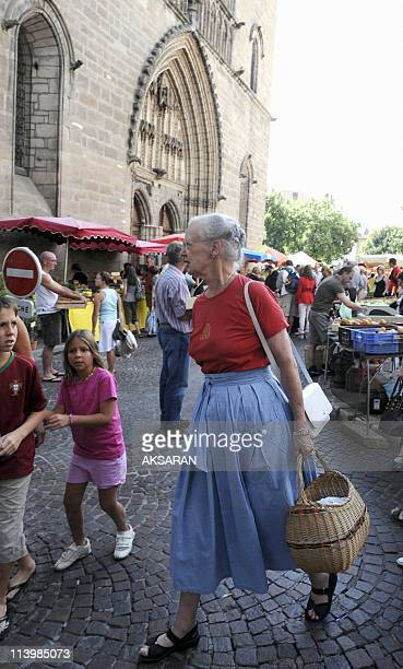 Queen Margrethe II of Denmark walks along the market of CaixLuzech during her shopping In Luzech France On August 09 2008The Danish Royal Couple...