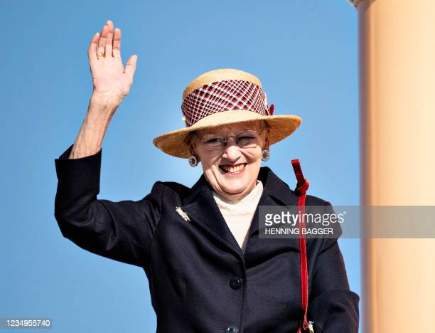 Queen Margrethe II of Denmark waves as she arrives with the royal yacht Dannebrog in Hanstholm during her summer voyage on August 30, 2021. - Denmark...